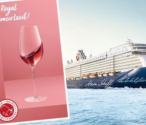 Ein Kreuzfahrt Schiff auf dem Meer mit rosa Rosé Royal Banner im Vordergrund
